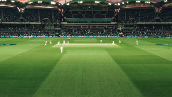 A wide view of a test cricket match that is in progress